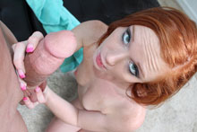 Redheaded teen Alex stroking huge cock